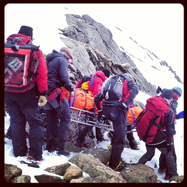 Stretcher carry over snowy ground